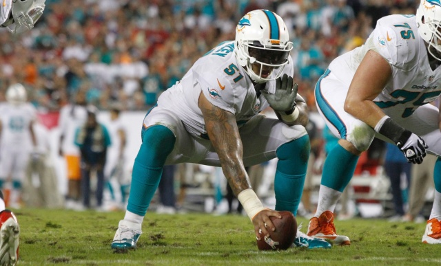 Miami Dolphins center Mike Pouncey gets ready to hike the ball against the Tampa Bay Lightning at Raymond James Stadium. (Kim Klement - USA TODAY Sports)