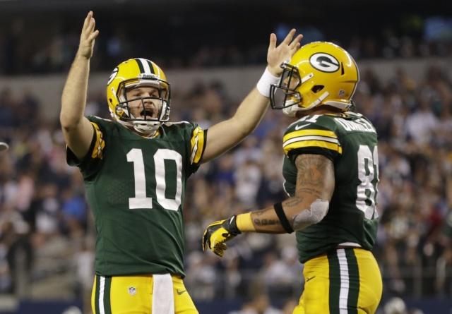 Green Bay Packers quarterback Matt Flynn reacts to a touchdown with tight end Andrew Quarless at AT&T Stadium. (Tim Heitman - USA TODAY Sports)