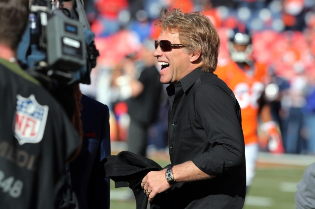 American musician Jon Bon Jovi on the field before during the 2013 AFC championship playoff football game between the Denver Broncos and the New England Patriots at Sports Authority Field at Mile High. (Matthew Emmons - USA TODAY Sports)