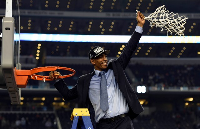 Connecticut Huskies head coach Kevin Ollie waves to fans after cutting down the net following the championship game of the Final Four in the 2014 NCAA Mens Division I Championship tournament against the Kentucky Wildcats at AT&T Stadium.  Robert Deutsch-USA TODAY Sports.