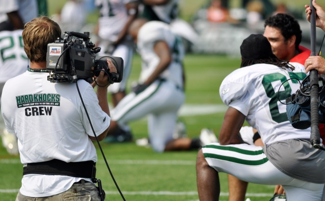Hard Knocks film crew document New York Jets quarterback Mark Sanchez, far right, and David Clowney durin a previous season of the show. (AP Photo/Kevin Rivoli)
