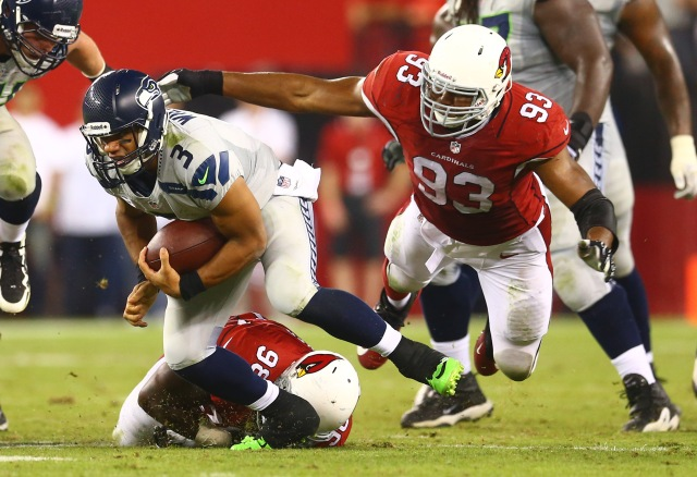 Seattle Seahawks quarterback Russell Wilson is pursued by Arizona Cardinals defensive end Calais Campbell during a game at University of Phoenix Stadium. (Mark J. Rebilas - USA TODAY Sports)