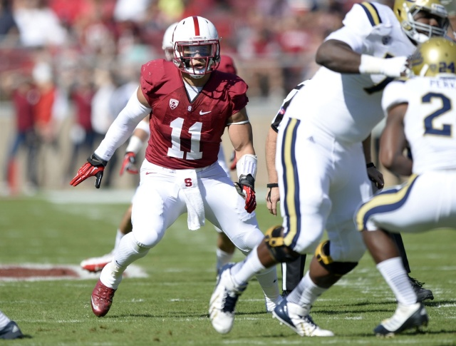Former Stanford Cardinal linebacker Shayne Skov (11) looks for the ball carrier during the second quarter against the UCLA Bruins at Stanford Stadium. (Bob Stanton - USA TODAY Sports)