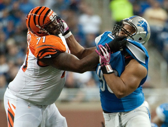 Cincinnati Bengals tackle Andre Smith blocks Detroit Lions defensive tackle Ndamukong Suh during a game at Ford Field. (Tim Fuller - USA TODAY Sports)