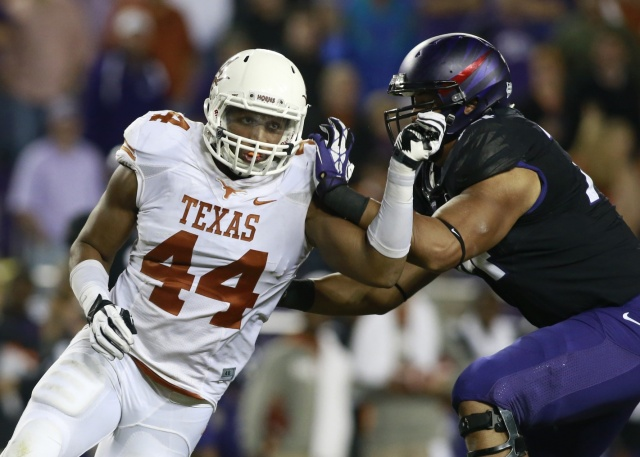 Former Texas Longhorns defensive end Jackson Jeffcoat rushes the passer against TCU Horned Frogs offensive tackle Halapoulivaati Vaitai at Amon G. Carter Stadium. (Tim Heitman - USA TODAY Sports)