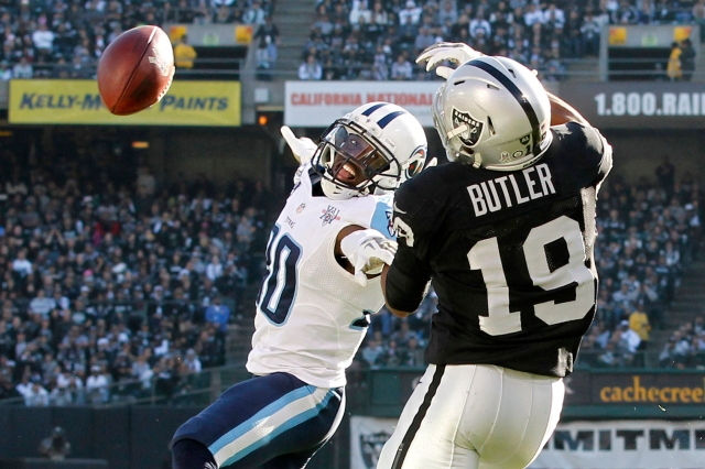 Tennessee Titans cornerback Jason McCourty breaks up a pass intended for Oakland Raiders wide receiver Brice Butler in a game at O.co Coliseum. (Cary Edmondson - USA TODAY Sports)