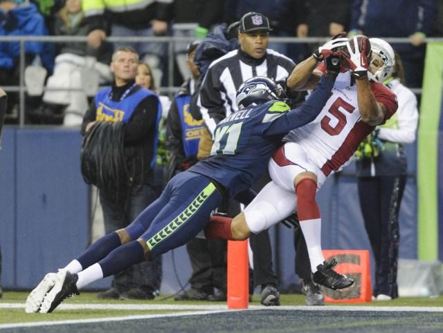 Seattle Seahawks cornerback Byron Maxwell (41) defends Arizona Cardinals wide receiver Michael Floyd (15) at CenturyLink Field. (Steven Bisig - USA TODAY Sports)