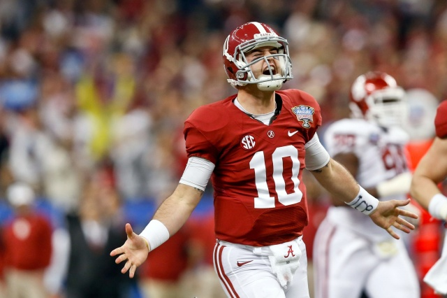 Former Alabama Crimson Tide quarterback AJ McCarron celebrates after a touchdown pass against the Oklahoma Sooners during a game at the Mercedes-Benz Superdome. (Derick E. Hingle - USA TODAY Sports)