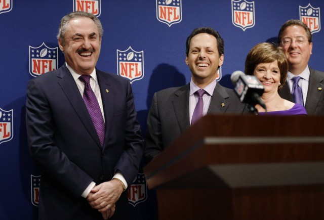 Minnesota Vikings owners Zygi Wilf, left, and Mark Wilf, right, speak at a news conference after Minneapolis was selected as the host for 2018 Super Bowl at the NFL's spring meeting, Tuesday, May 20, 2014, in Atlanta. Minneapolis will host the 2018 Super Bowl after a vote by owners on Tuesday rewarded the city for getting a new stadium deal. The owners chose Minneapolis and the new $1 billion stadium planned for the site of the old Metrodome to host the championship over New Orleans and Indianapolis. (David Goldman - Associated Press)