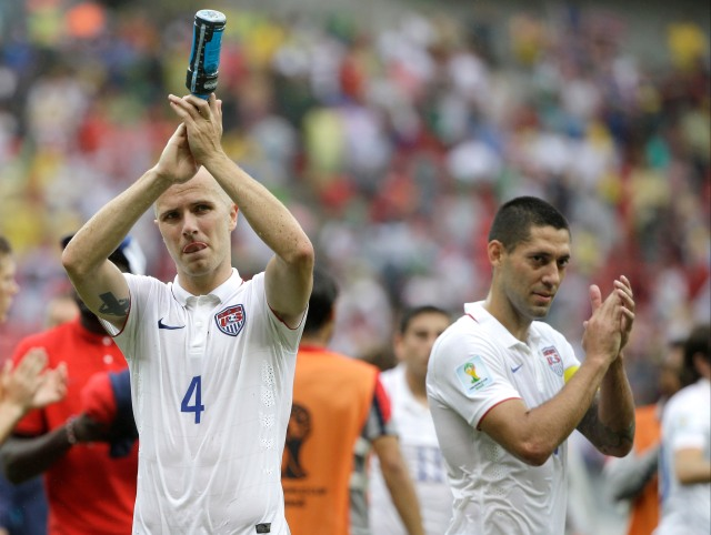 United States' Michael Bradley, left, and Clint Dempsey applaud after qualifying for the next World Cup round following their 1-0 loss to Germany. (AP Photo/Ricardo Mazalan)