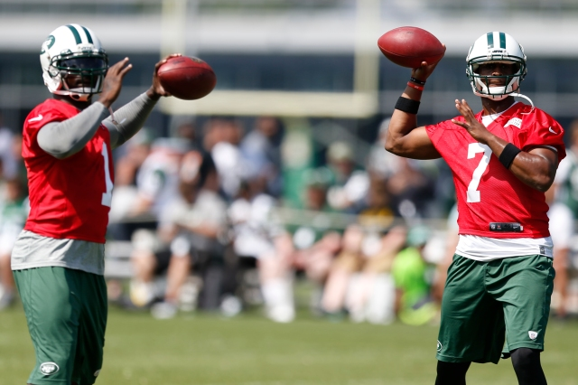 Michael Vick (left) and Geno Smith (AP Photo/Julio Cortez)