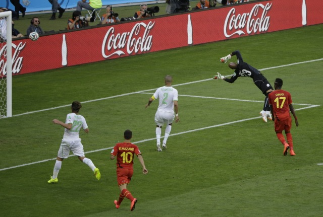 Dries Mertens' shot flies past Algeria keeper Cedric Si Mohamed to give Belgium a 2-1 lead. (Sergei Grits, AP Photo)