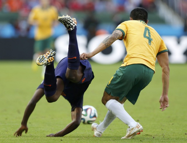 This tackle earned Australia captain Tim Cahill a yellow card, his second of the tournament. As a result, he'll miss the Socceroos' final match in group play against Spain. (Edgard Garrido, REUTERS)