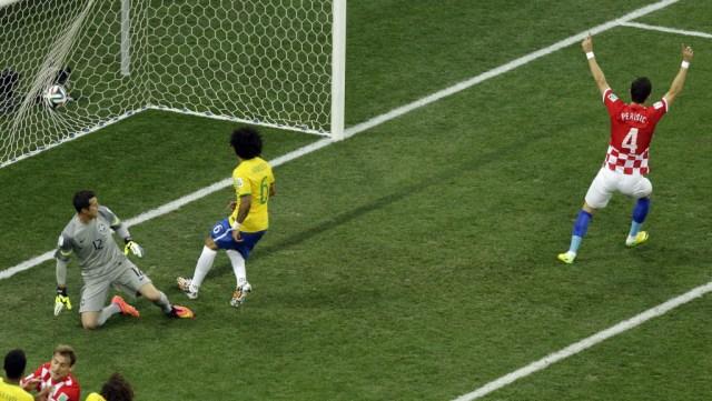 Croatia's Ivan Perisic (4) celebrates as Brazil's Marcelo (6) scores an own goal. (Thanassis Stavrakis, AP Photo)