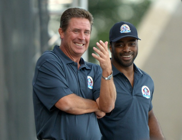 Dan Marino (left) and Curtis Martin at the 2013 Pro Football Hall of Fame Enshrinement at Fawcett Stadium. Mandatory. (Kirby Lee, USA TODAY Sports)