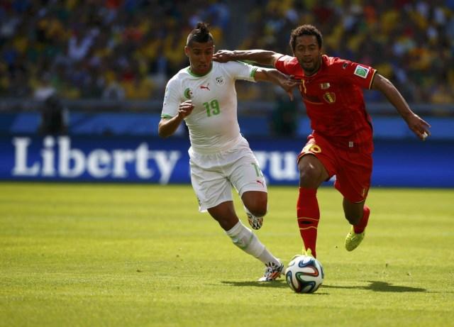 Algeria's Saphir Taider has a great mohawk.  Belgium's Moussa Dembele chases him. (Michael Dalder, REUTERS)