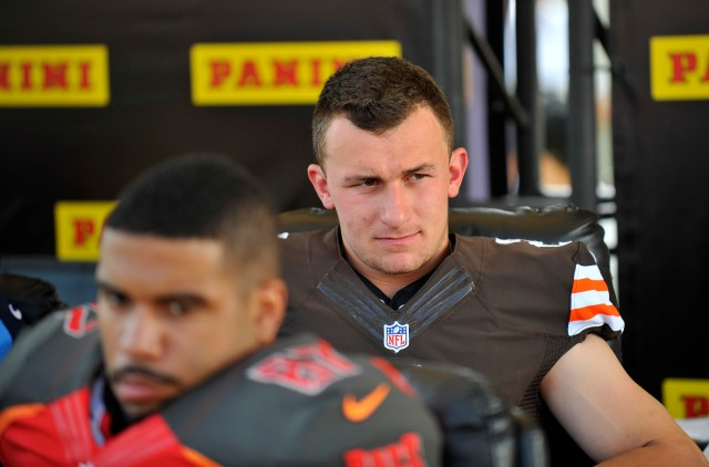 Johnny Manziel's slow transition to the NFL is reminiscent of another hyped Heisman winner. (Gary A. Vasquez, USA TODAY Sports)
