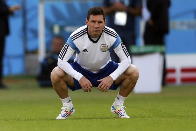Argentina star Lionel Messi stretches during training. (Marko Djurica, REUTERS)