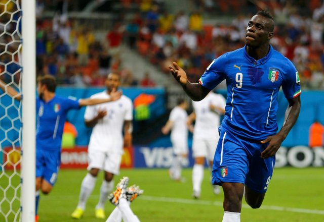 Mario Balotelli celebrates his goal against England. (REUTERS/Ivan Alvarado)