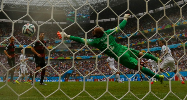 Germany's Thomas Mueller (unseen) scores past goalkeeper Tim Howard of the U.S. (REUTERS/Brian Snyder)