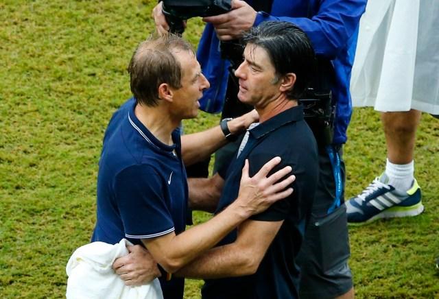 U.S. coach Juergen Klinsmann (L)  hugs Germany's coach Joachim Low. (REUTERS/Ruben Sprich)