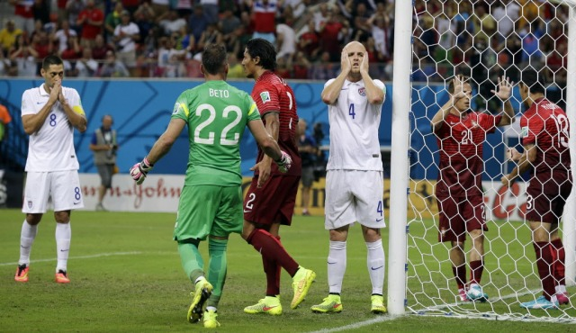 United States' Michael Bradley (4) reacts after his shot on an open goal was blocked by Portugal's Ricardo Costa (13). (Martin Mejia, AP Photo)