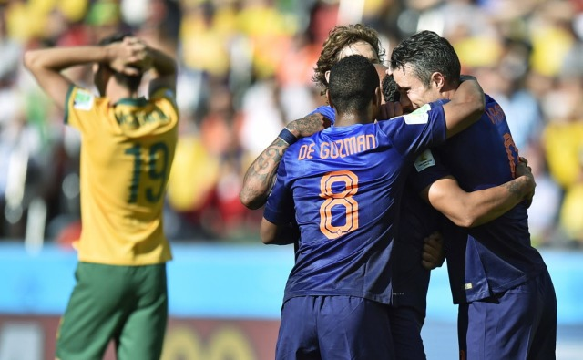 Dutch players celebrate after Netherlands' Memphis Depay scored his side's third goal. (Martin Meissner, AP Photo)