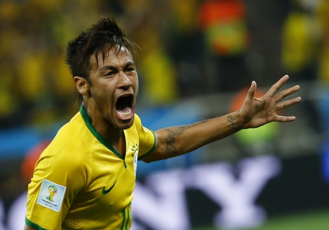 Brazil striker Neymar delivered on the pre-tournament hype, scoring twice in the opening game of the World Cup. (Damir Sagolj, REUTERS)