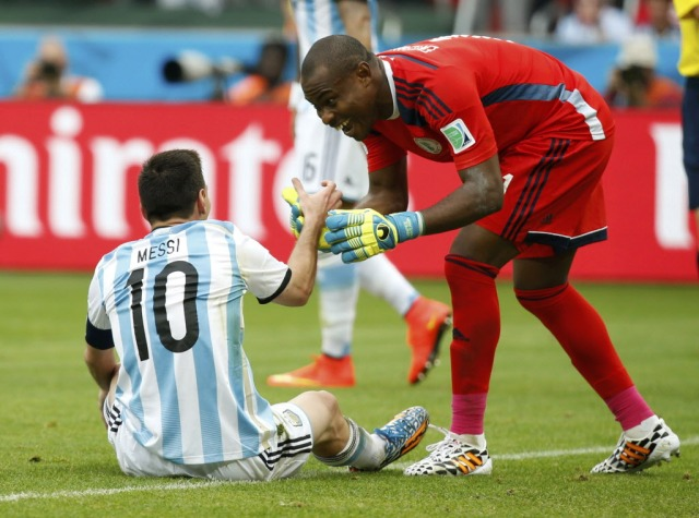 Nigeria's goalkeeper Vincent Enyeama, shown here helping Lionel Messi to his feet, gave up three goals to Argentina and must improve if his squad is to have any chance against France. (Edgard Garrido, REUTERS)