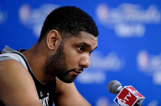 Tim Duncan (21) speaks to the media after practice before game one of the 2014 NBA Finals. (Bob Donnan, USA TODAY Sports.)
