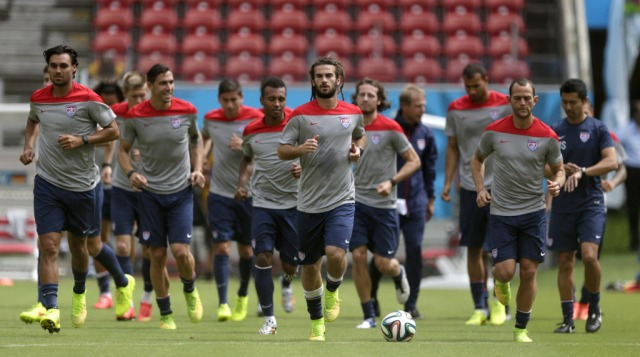 United States' Kyle Beckerman, center, jogs with teammates during a training session in Recife. (Julio Cortez, AP Photo)