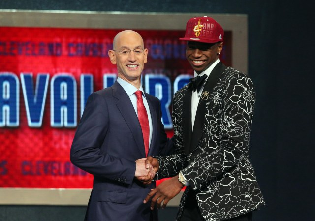 Andrew Wiggins shakes Commissioner Adam Silver's hand. (Brad Penner, USA TODAY Sports)