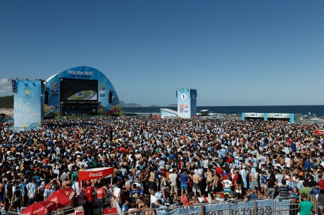 Soccer fans gather to watch the final World Cup match between Argentina and Germany on a giant screen on Copacabana beach. (AP Photo/Silvia Izquierdo)
