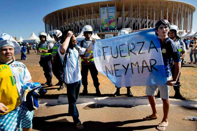 "Fans of Argentina's national soccer team hold a banner with a message that reads in Spanish; ""Strength Neyma.,""(AP Photo/Rodrigo Abd)"