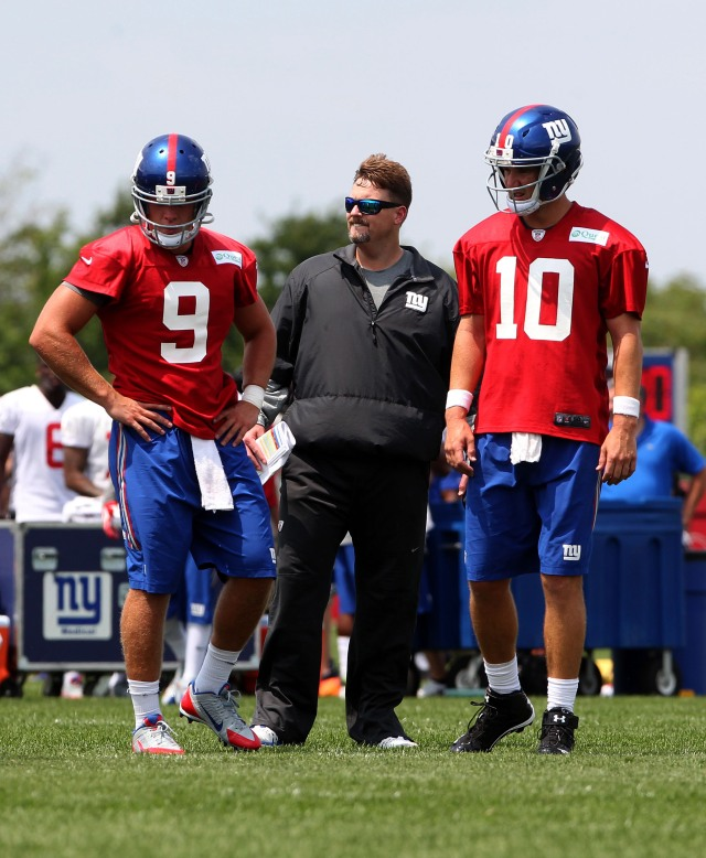 Giants QBs Ryan Nesbitt, left, and Eli Manning, right, confer with new offensive coordinator Ben McAdoo during a training camp practice. (Noah K. Murray, USA TODAY Sports)