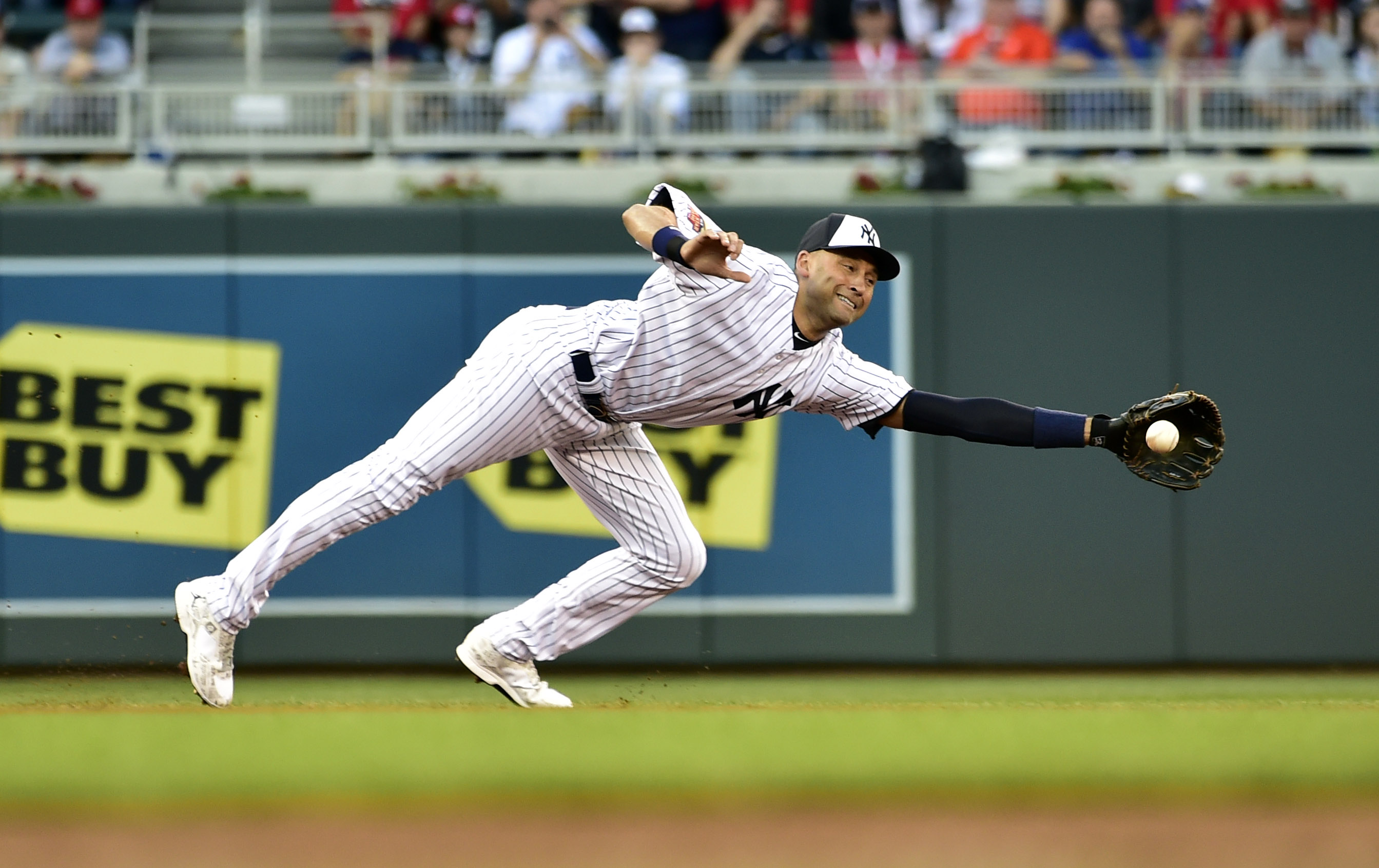 Derek Jeter makes a diving stop on a ball hit by Andrew McCutchen to lead off the 85 All-Star Game. (Scott Rovak, USA TODAY Sports)