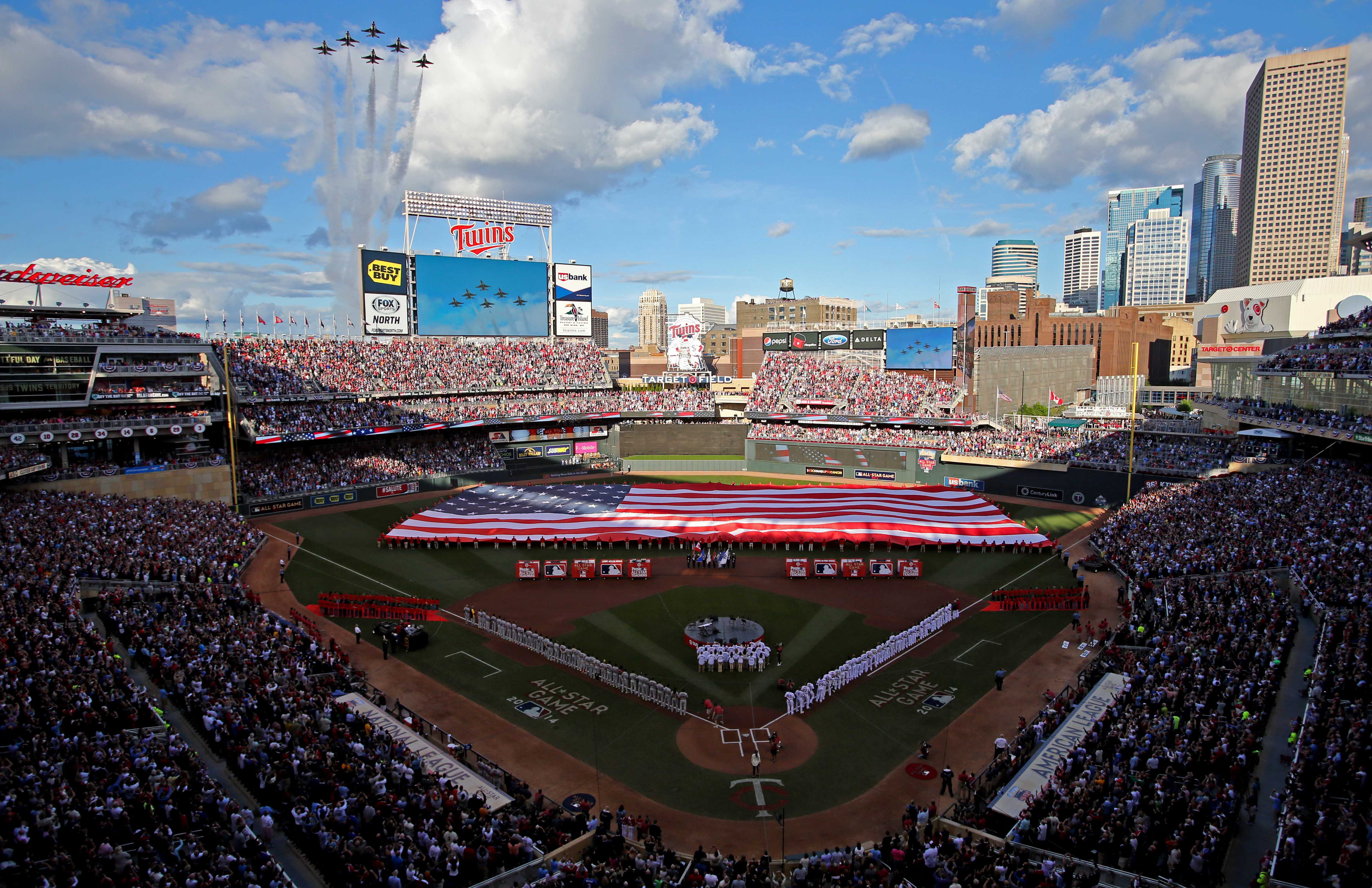 The U.S. Air Force Thunderbirds perform a flyover during the national anthem before the All Star Game at Target Field.