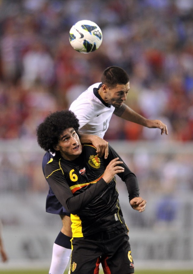 Belgium midfielder Marouane Fellaini (6) and USA forward Clint Dempsey battle for the ball. (David Richard, USA TODAY Sports)