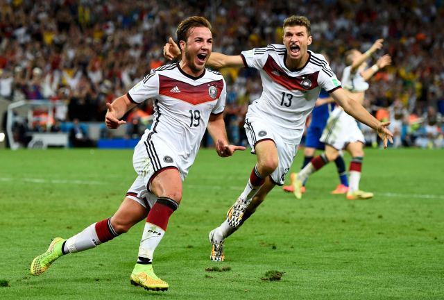 Germany's Mario Goetze (L) celebrates near teammate Thomas Mueller after scoring a goal during extra time. (REUTERS/Dylan Martinez)