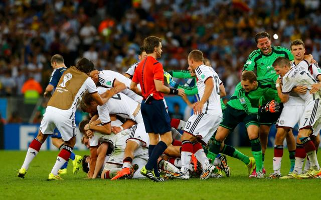 Germany's players celebrate after their win against Argentina in their 2014 World Cup final. (REUTERS/Darren Staples)