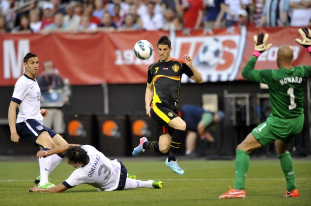 Belgium forward Kevin Mirallas (7) leaps in the air while scoring a goal against the USA in the first half . (David Richard, USA TODAY Sports)