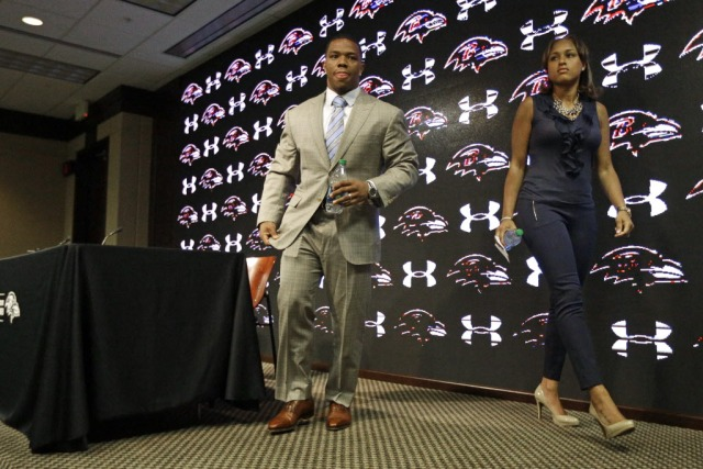 left, leaves a NFL football news conference with his wife Janay where they discussed his arrest on aggravated assault charges. (Patrick Semansky, AP Photo)