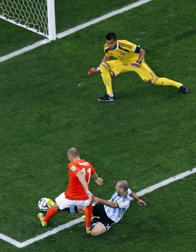 Netherlands' Arjen Robben (11) is tackled by Argentina's Javier Mascherano in the final minutes of regular time. (Fabrizio Bensch, AP Photo)