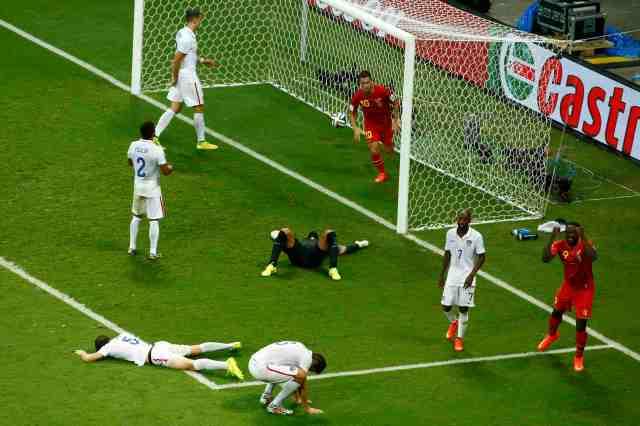 U.S. players react to Belgium's first goal.