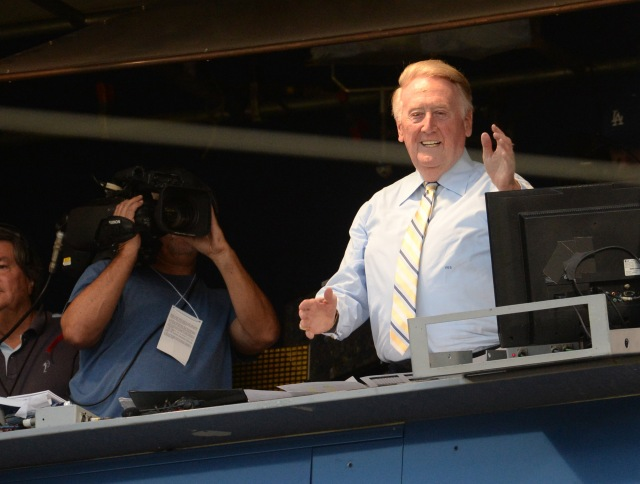 Vin Scully gets applause from the crowd after it was announced he would return to Dodgers booth for the 66th season. (Jayne Kamin-Oncea-USA TODAY Sports)