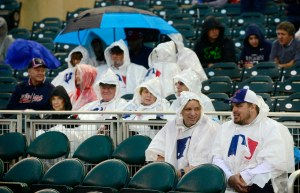 Fans at Target Field have their rain ponchos on, but the Home Run Derby is underway after a one-hour delay. (Jeff Curry, USA TODAY Sports)