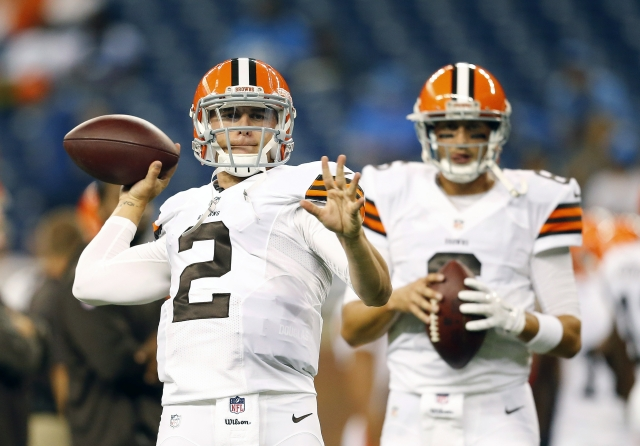 Browns QBs Johnny Manziel (2) and Brian Hoyer are still locked in a positional battle. (Rick Osentoski/AP)