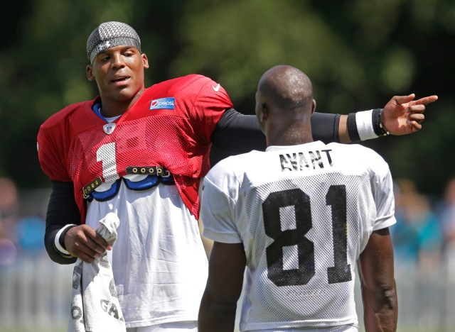 Cam Newton (left) will have to establish a rapport with Jason Avant (right), one of the Panthers' few weapons at WR. (Chuck Burton, AP)