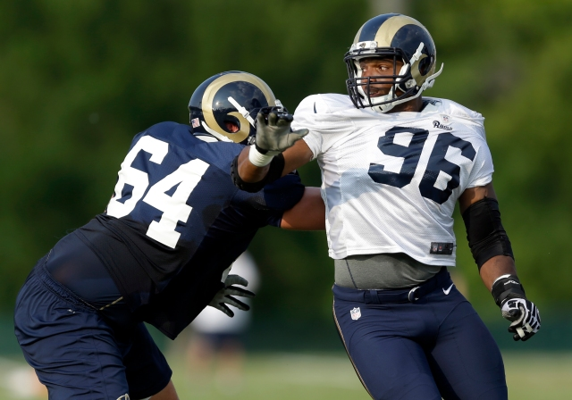 Michael Sam (right) makes his anticipated NFL debut against the Saints. (Jeff Roberson, AP)