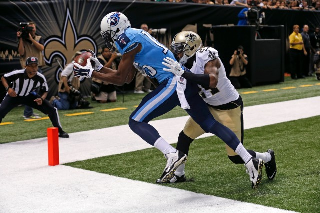 Titans WR Justin Hunter gets his toes down for one of his Friday night TDs in New Orleans. (Bill Haber-AP)